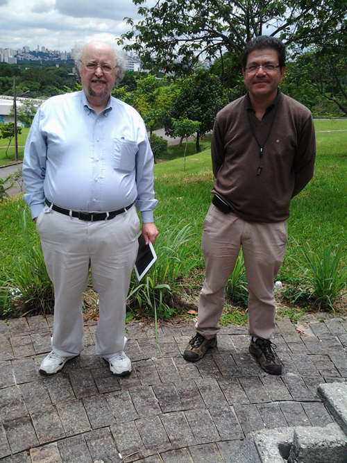 Dr. Jeff Lindemuth and Marcelo pose in front of the Sao Paulo skyline.