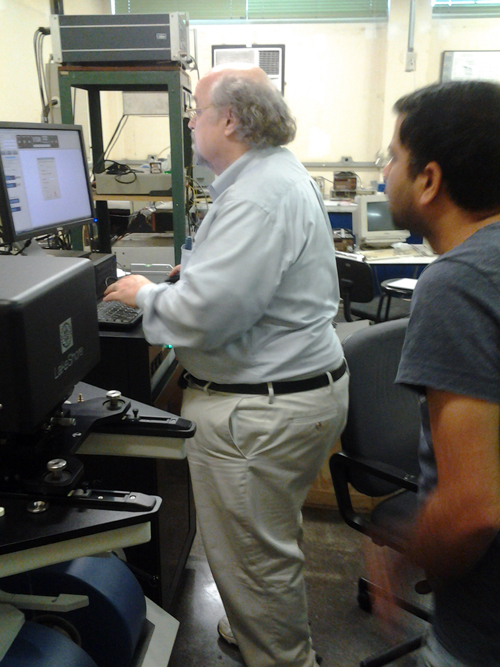 Jeff assists a member of the Institute of Physics at one of their first measurements using their new Lake Shore VSM.